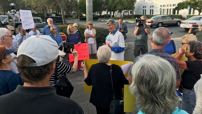 Former Martin County Commissioner Maggy Hurchalla, center, speaks to supporters of commissioners Sarah Heard, Ed Fielding and former commissioner Anne Scott during a rally outside Blake Library in Stuart on Jan. 23.