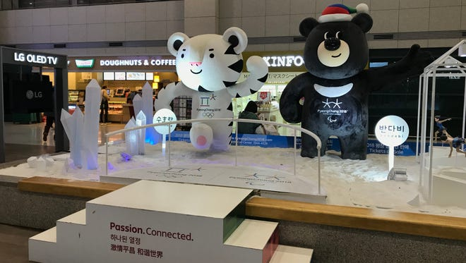 The Olympic and Paralympic mascots greet visitors.