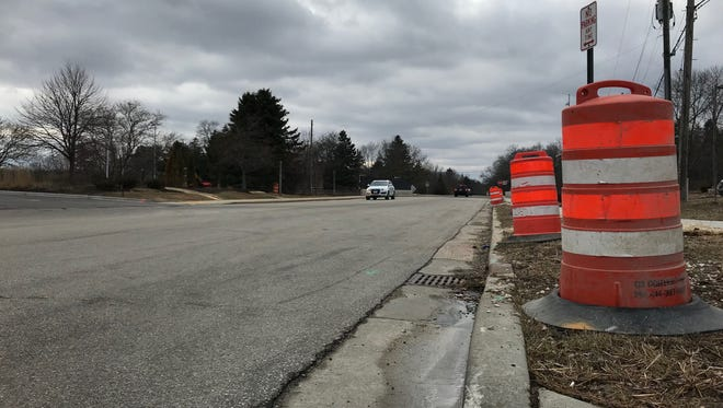 Orange construction barrels have been lined up along the 400 block of West Green Tree Road in anticipation of a bridge reconstruction project that will start April 24.