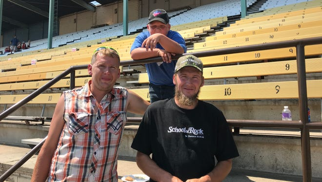Lyle Bothe, left, and his brother Lance Bothe, right, attended agriculture appreciation day at the Sioux Empire Fair Wednesday. They are pictured here with Lyle's son Nathan.