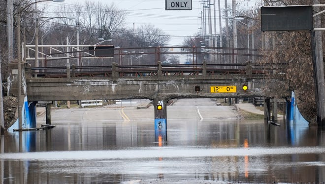 Pennsylvania Avenue at the Potter Park Zoo entrance in Lansing, Michigan was closed due to flooding in late February.