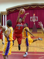 Supermanamko West all-star Cesar Villanueva (8) passes the ball in the air during the Filipino Sports Association of Guam hoops all-star game at the Father Duenas Phoenix Center in Mangilao on Jan. 10.