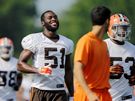 Cleveland Browns outside linebacker Barkevious Mingo (51) jogs to the next drill at the NFL football team's training camp in Berea, Ohio, Sunday, July 27, 2014. (AP Photo/Mark Duncan)