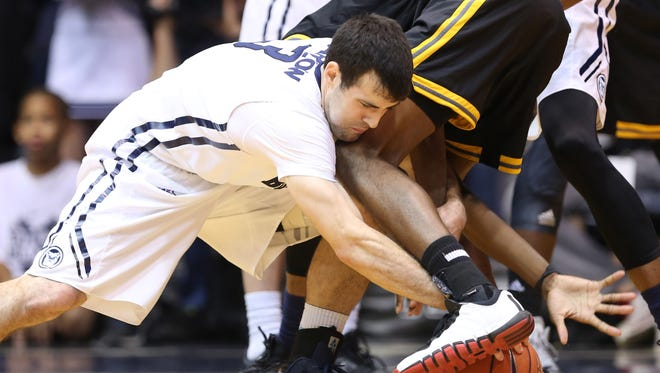 Butler's Alex Barlow goes for a loose ball against Kennesaw State in the first half of the game at Hinkle Fieldhouse Monday December 8, 2014.