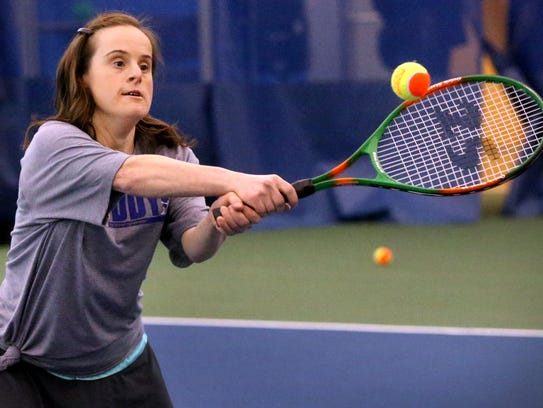 Heather Young plays tennis as part of the Buddy Up