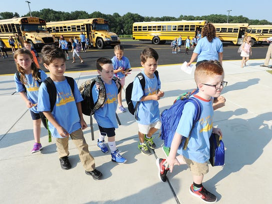 Students start their first day of school at the new