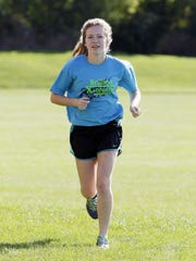 Kiel cross country runner Rachel Halbach jogs before practice Wednesday September 28, 2016 in Kiel.