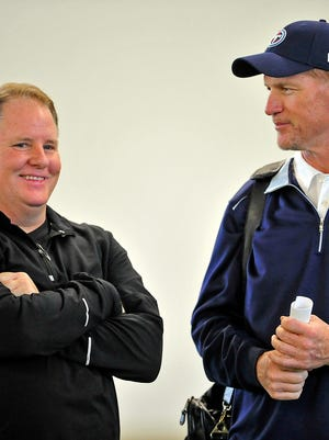 Former Titans head coach Ken Whisenhunt, right, talks with former Philadelphia Eagles head coach Chip Kelly during the Vanderbilt Pro Day in Nashville on March 21, 2014.