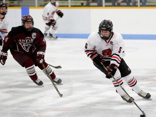 SPASH's Mark Stoskopf (5) carries the puck during the