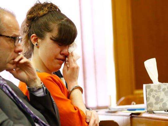 Ashlee Martinson wipes away tears while watching a video clip during her sentencing Friday, June 10, 2016, at Oneida County Courthouse in Rhineland. Next to Martinson is her defense attorney Thomas Wilmouth.