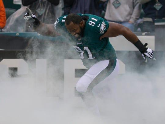 Philadelphia Eagles' Fletcher Cox runs onto the field