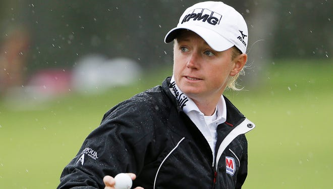 Stacy Lewis holds up her ball on the ninth green of the Lake Merced Golf Club after finishing the second round of the Swinging Skirts LPGA Classic in Daly City, Calif.
