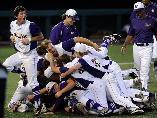 Wylie players celebrate after the final out of the