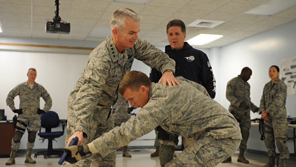 Gen. Paul Selva practices combatives with 1st Lt. Anthony