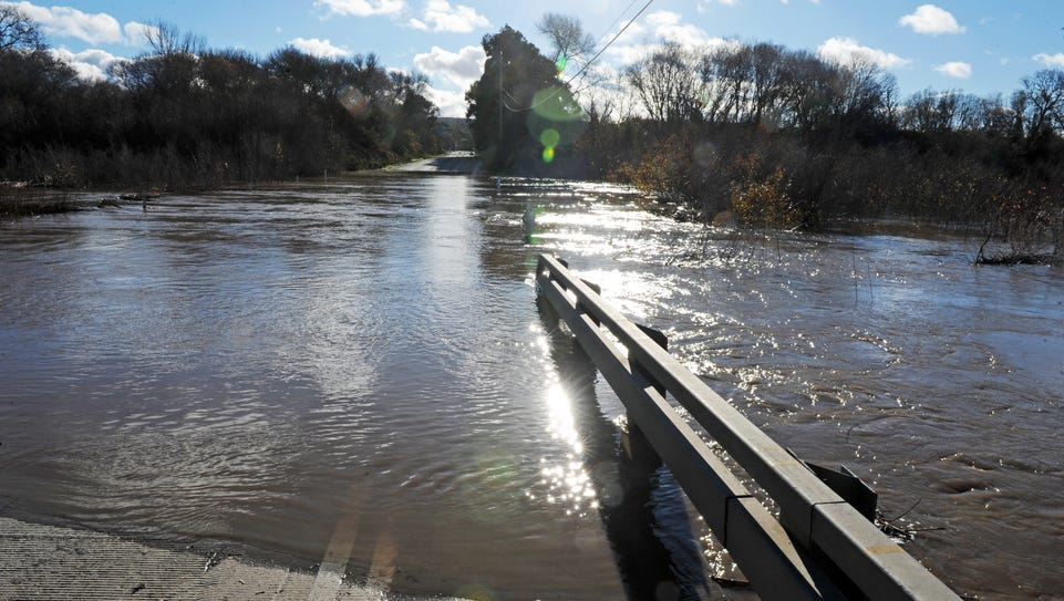 Davis Road disappears under the Salinas River on Thursday