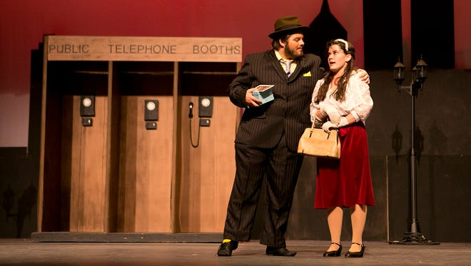 Rayvn Knipple, left, and Taylor Hauke, right, perform as Nathan Detroit and Miss Adelaide during rehearsal for Lincoln High School's performance of 'Guys and Dolls' at the Performing Arts Center in Wisconsin Rapids, Monday, April 20, 2015.