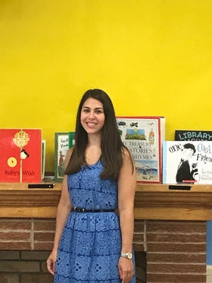 Trista Gaspari, who will be teaching the new pre-K program at the Harrington Park School, stands in the classroom that is being remodeled during the summer months to prepare for September.