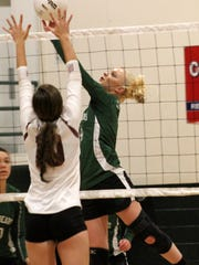 Jackie Ainsworth lifts a ball over Tularosa's Gracie