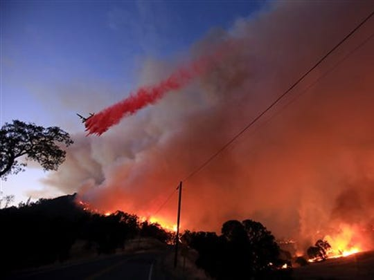 An air tanker drops retardant at the Rocky Fire as