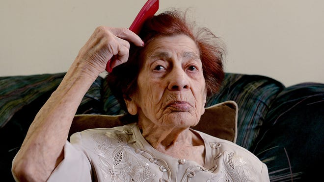 Asya Titova combs her hair in her room at the Burcham Hills Retirement Community. Titova fled Turkey in the aftermath of the 1915 Armenian genocide to the Soviet Union. She later received refugee status in the United States after atrocities after mass killings of Armenians in Azerbaijan.