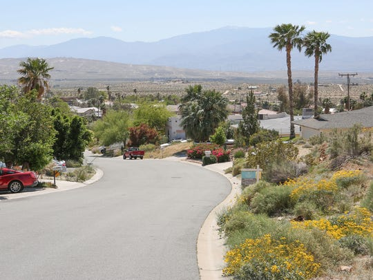A neighborhood overlooking the city on Redbud Road in Desert Hot Springs, where Dori Petee and her family rent a five-bedroom house.