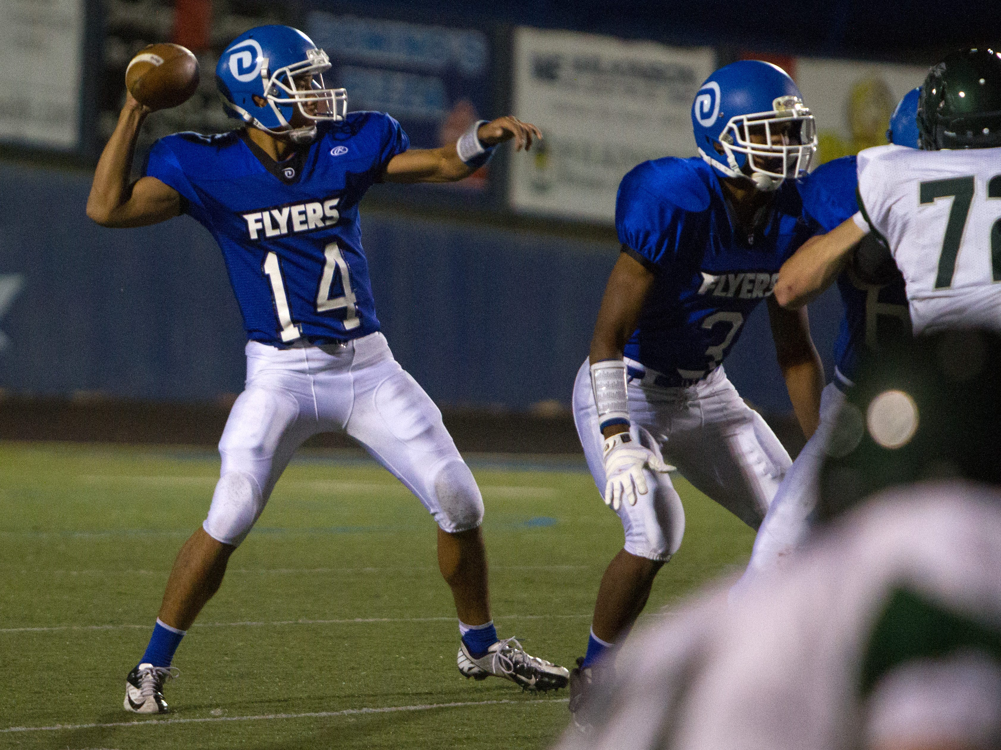 Dixie quarterback Ammon Takau hurls a pass in the first half against the Payson Lions last season.