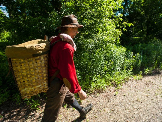 Michael DeBonis, the executive director of the Green Mountain Club, is hiking the length of the Long Trail using only the equipment available to the trail's founders when it was established in 1917.  DeBonis heads back into the hills after canoeing across the Winooski River in Bolton on Wednesday, June 22, 2017, eschewing the footbridge built a few years ago.