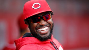 Cincinnati Reds second baseman Brandon Phillips (4) emerges from the clubhouse in the third inning of the MLB National League regular-season finale game between the Cincinnati Reds and the Chicago Cubs at Great American Ball Park in downtown Cincinnati on Sunday, Oct. 2, 2016.