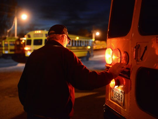 Lamers bus driver Earl Habeck completes an inspection of his bus at 6:15 a.m., prior to starting his route serving Lombardi Middle School in Green Bay.