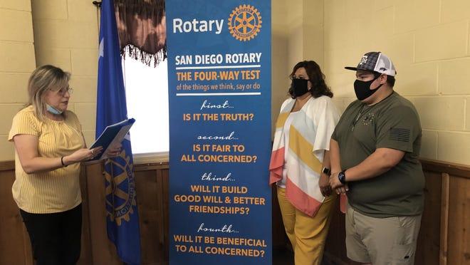 Rotarian Bibi Casas inducted Lamar Vela and Gabriel Vera into the San Diego Rotary Club.
