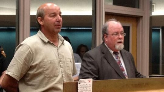 Green Township resident Leonard Pflanz (left) and his lawyer, Tim Nolan