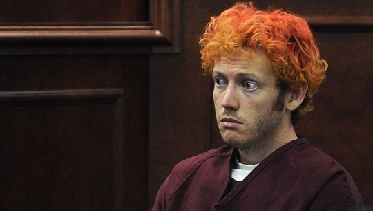 James Holmes, shown in a July 12, 2012 file photo, who was charged with killing 12 moviegoers and wounding 70 more in a shooting spree in a crowded theater in Aurora, Colo., in July 2012, sits in Arapahoe County District Court in Centennial, Colo.