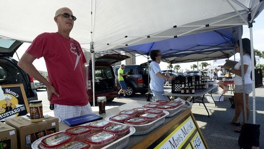 Matt Bartlett of Matt's Mom's Mustard waits to give out samples to customers last week at the Beach Market at the Casino Beach parking lot. Market in the Breeze, a weekly, year-round farmers market, is tentatively set to kick off Aug. 18 and run every Tuesday in the Gulf Breeze Community Center parking lot, joining several area markets to bring local, farm-fresh produce and homemade arts and baked goods to the community.