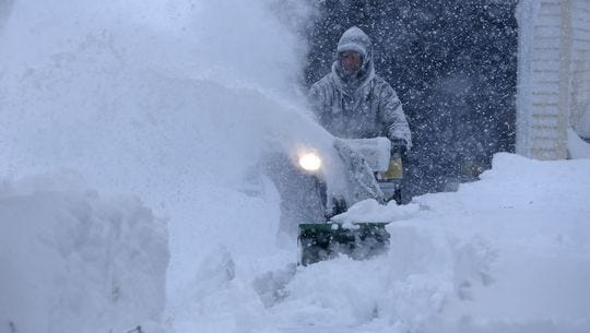 Jerry Delzer attempts to clear the snow in his driveway in Depew.