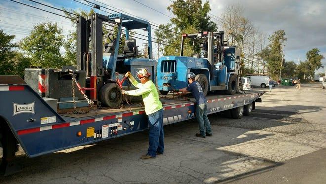 Boulter forklifts are loaded for transport.