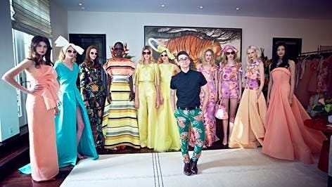 Designer Christian Siriano standing with models wearing his Resort 16 line.