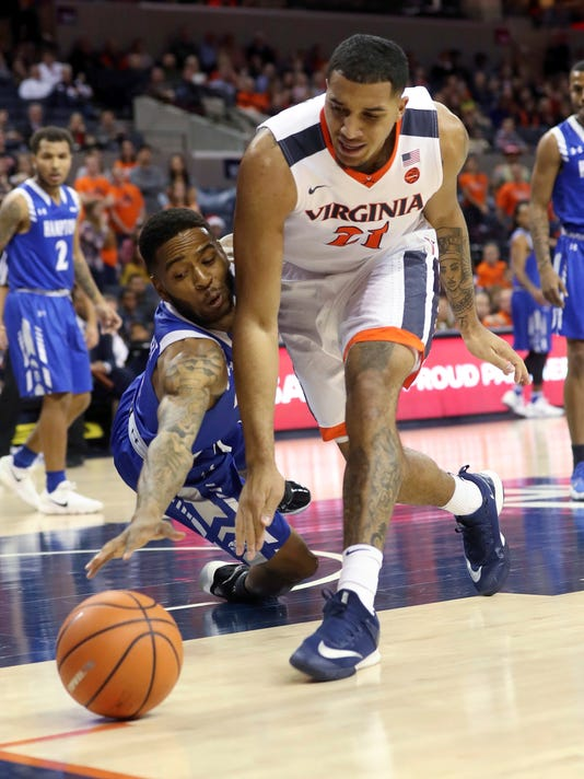 Virginia forward Isaiah Wilkins (21) and Hampton guard Malique Trent reach for a loose ball during an NCAA college basketball game Friday, Dec. 22, 2017, in Charlottesville, Va. (AP Photo/Andrew Shurtleff)