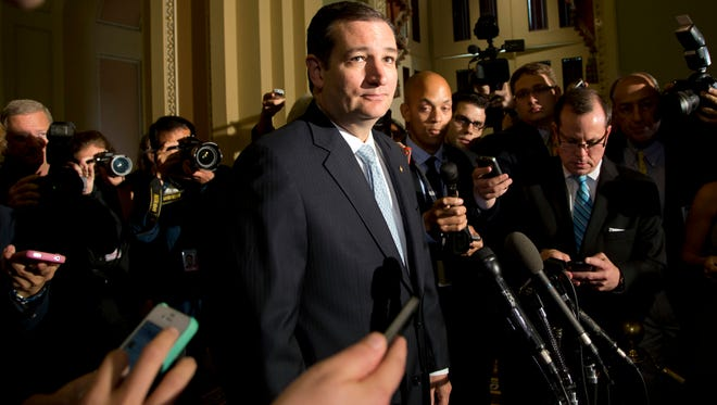 Sen. Ted Cruz, R-Texas, speaks with reporters on Capitol Hill in Washington.