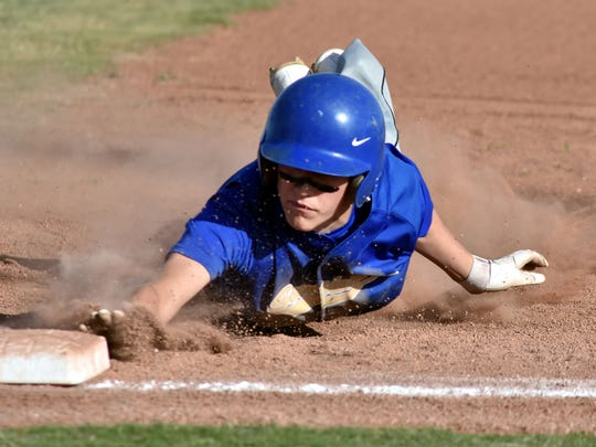 Mesilla Valley Christian center fielder Noah Coyle dives back to first base as Mesilla Valley took on Onate High's junior varsity team Tuesday at the Field of Dreams Baseball Complex.