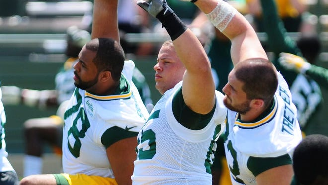 Offensive linemen, from left, Derek Sherrod, Lane Taylor and JC Tretter, will be counted on to step into larger roles this season.