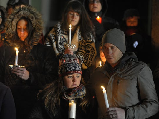 Megan and David Menke and about 50 other people gathered Monday for a candlelight vigil in support of survivors of sexual assault on the steps of the Parthenon.