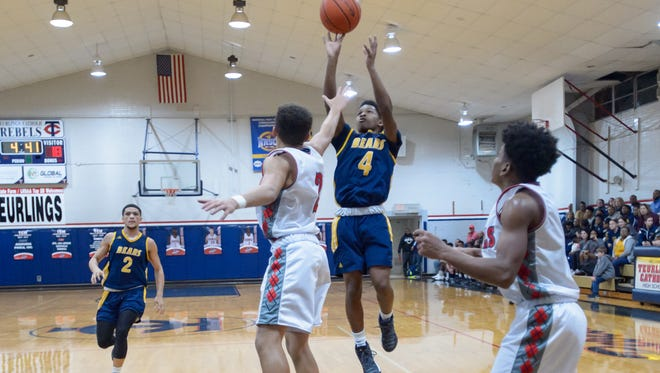 Carencro's Artrell Marks shoots for two as the Teurlings Rebels take on the Carencro Bears. Friday, Jan. 27, 2017.