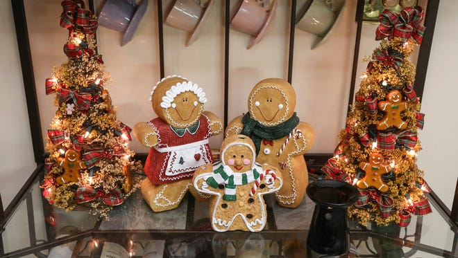 Decorative holiday figures adorn a baking rack in the kitchen in Sharon Chandler's condo.November 28, 2016