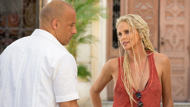 Dom (VIn Diesel is recruited by cyberterrorist Cipher (Charlize Theron) in 'The Fate of the Furious.'