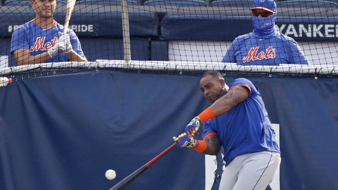 New York Mets Michael Conforto, left, watches as Yoenis Cespedes takes batting practice in the cage before an exhibition game against the New York Yankees on Sunday at Yankee Stadium.