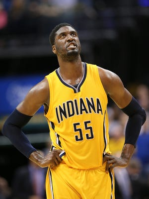 Indiana Pacers center Roy Hibbert fights through the fatigue and frustration near the beginning of overtime against the Wizards. The Pacers beat the Washington Wizards 99-95 in double overtime at Bankers Life Fieldhouse on Tuesday, April 14, 2015.