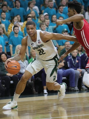 Michigan State guard Miles Bridges  drives against Wisconsin forward Alem Ford during first half action Friday, January 26, 2018 at the Breslin Center in East Lansing.