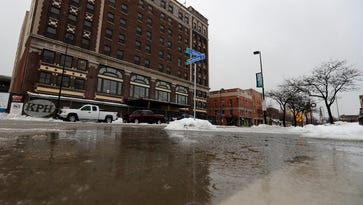 A large puddle of icy water is shown on the corner of Adams and Northland downtown on Tuesday, January 10, 2017, in Green Bay.