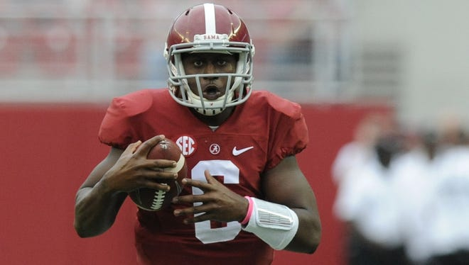 Alabama quarterback Blake Sims threw for two touchdowns and ran for another against Southern Miss. Alabama quarterback Blake Sims (6) scrambles for yardage against Southern Miss at Bryant Denny Stadium in Tuscaloosa, Ala. on Saturday September 13,  2014.