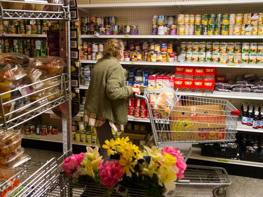 A woman selects food items at the Iron County Care & Share, November 14, 2017.
